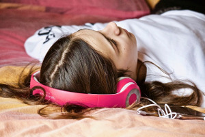 girl lying with headphones