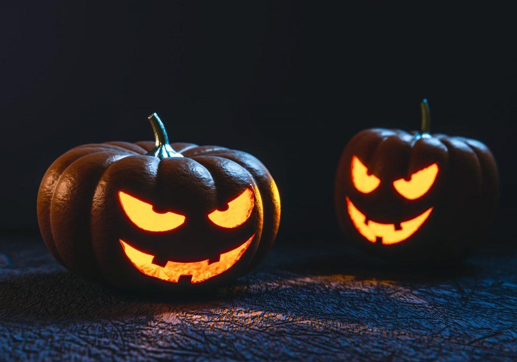 2 sinister carved halloween pumpkins