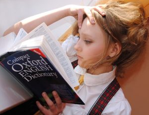 Girl reading oxford English dictionary