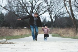 Father running with child